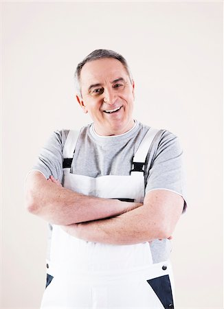 painter - Portrait of Man wearing Overalls, Studio Shot Stock Photo - Premium Royalty-Free, Code: 600-06786997