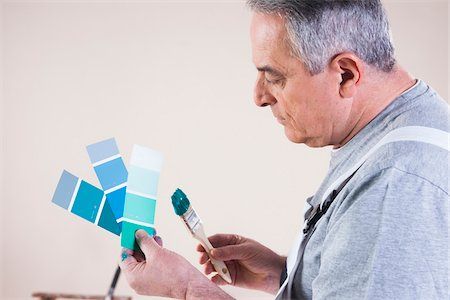 painter - Senior Man looking at Paint Colour Samples, Studio Shot Stock Photo - Premium Royalty-Free, Code: 600-06787007