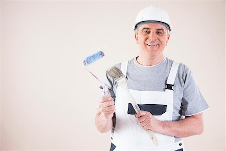 painter - Portrait of Painter with Paint Brush and Roller, Studio Shot Stock Photo - Premium Royalty-Free, Code: 600-06787000