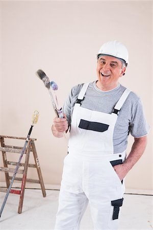 painter - Portrait of Painter with Paint Brush and Roller, Studio Shot Stock Photo - Premium Royalty-Free, Code: 600-06787001