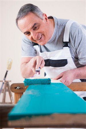 paint - Senior Man Painting Board with Blue Paint, Studio Shot Stock Photo - Premium Royalty-Free, Code: 600-06787002