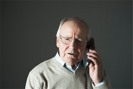 phone cord - Elderly Man Talking on Phone in Studio Stock Photo - Premium Royalty-Free, Code: 600-06787026
