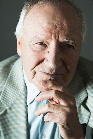 Close-up Portrait of Elderly Man in Studio Stock Photo - Premium Royalty-Free, Code: 600-06787022