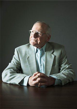 Portrait of Elderly Man in Studio Stock Photo - Premium Royalty-Free, Code: 600-06787023