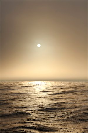 The Atlantic ocean illuminated off the coast of Nova Scotia in fog with the sun shining through. Stock Photo - Premium Royalty-Free, Code: 600-06782114