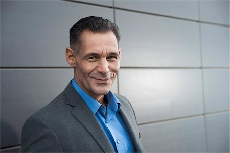 portrait smile caucasian one - Portrait of businessman standing in front of building, Mannheim, Germany Stock Photo - Premium Royalty-Free, Code: 600-06782191
