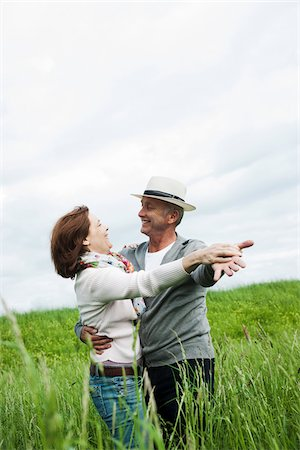 Mature couple dancing in field of grass, Germany Stock Photo - Premium Royalty-Free, Code: 600-06782238