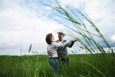 european - Mature couple dancing in field of grass, Germany Stock Photo - Premium Royalty-Free, Code: 600-06782244