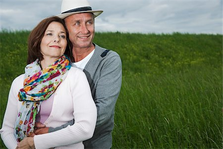Close-up portrait of mature couple standing in field of grass, embracing, Germany Stock Photo - Premium Royalty-Free, Code: 600-06782241