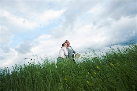 Mature couple walking in field of grass, Germany Stock Photo - Premium Royalty-Free, Code: 600-06782250