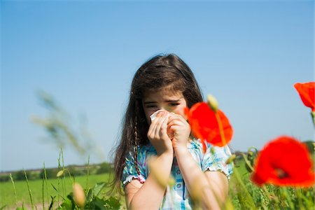 reaction - Girl Blowing Nose in Flower Field, Mannheim, Baden-Wurttemberg, Germany Stock Photo - Premium Royalty-Free, Code: 600-06808916