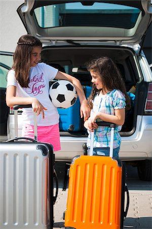 Girls Loading Luggage in Van for Vacation, Mannheim, Baden-Wurttemberg, Germany Stock Photo - Premium Royalty-Free, Code: 600-06808924