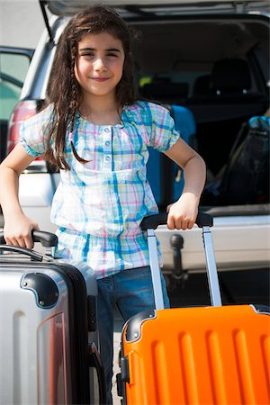 Girl Loading Luggage in Van for Vacation, Mannheim, Baden-Wurttemberg, Germany Stock Photo - Premium Royalty-Free, Code: 600-06808925