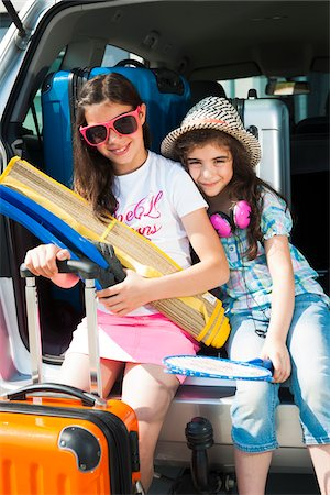 Portrait of Sisters in Trunk of Van Getting ready for Vacation, Mannheim, Baden-Wurttemberg, Germany Stock Photo - Premium Royalty-Free, Code: 600-06808921