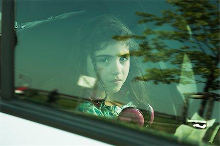 Girl in Minivan through Window, Mannheim, Baden- Wurttemberg, Germany Stock Photo - Premium Royalty-Free, Code: 600-06808922