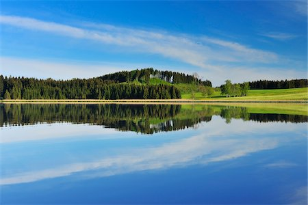 Landscape and Sky Reflecting in Lake, Sameister Weiher, Rosshaupten, Bavaria, Germany Stock Photo - Premium Royalty-Free, Code: 600-06803883