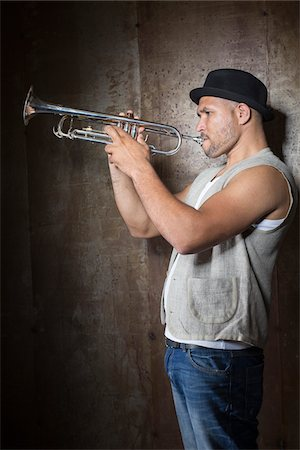 Portrait of Musician Playing Trumpet, Studio Shot Stock Photo - Premium Royalty-Free, Code: 600-06803954