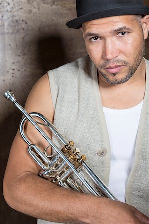 Portrait of Musician holding Trumpet, Studio Shot Stock Photo - Premium Royalty-Free, Code: 600-06803955