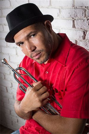 Portrait of Musician holding Trumpet, Studio Shot Stock Photo - Premium Royalty-Free, Code: 600-06803951