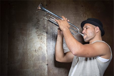 Portrait of Musician Playing Trumpet, Studio Shot Stock Photo - Premium Royalty-Free, Code: 600-06803953