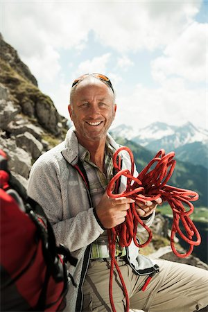 Portrait of Man Hiking in Mountains, Tannheimer Tal, Tyrol, Austria Stock Photo - Premium Royalty-Free, Code: 600-06819398