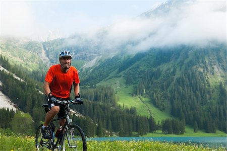 Mature Man Riding Mountain Bike by Vilsalpsee, Tannheim Valley, Tyrol, Austria Stock Photo - Premium Royalty-Free, Code: 600-06819406