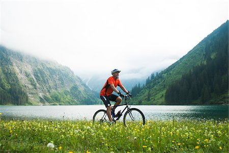 Mature Man Riding Mountain Bike by Vilsalpsee, Tannheim Valley, Tyrol, Austria Stock Photo - Premium Royalty-Free, Code: 600-06819408