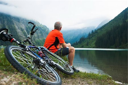 people mountain biking - Mature Man Sitting by Lake with Mountain Bike, Vilsalpsee, Tannheim Valley, Tyrol, Austria Stock Photo - Premium Royalty-Free, Code: 600-06819401