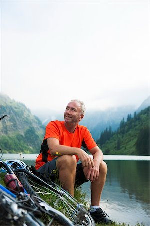 people mountain biking - Mature Man Sitting by Lake with Mountain Bike, Vilsalpsee, Tannheim Valley, Tyrol, Austria Stock Photo - Premium Royalty-Free, Code: 600-06819402