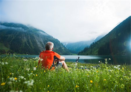 Mature Man with Mountain Bike sitting by Lake, Vilsalpsee, Tannheim Valley, Tyrol, Austria Stock Photo - Premium Royalty-Free, Code: 600-06819416