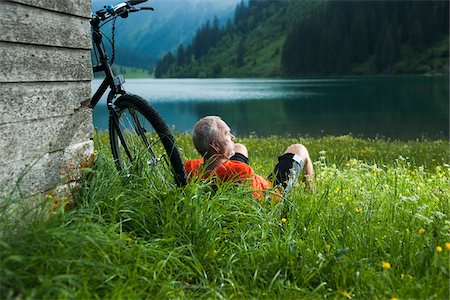people mountain biking - Mature Man with Mountain Bike Relaxing by Lake, Vilsalpsee, Tannheim Valley, Tyrol, Austria Stock Photo - Premium Royalty-Free, Code: 600-06819418