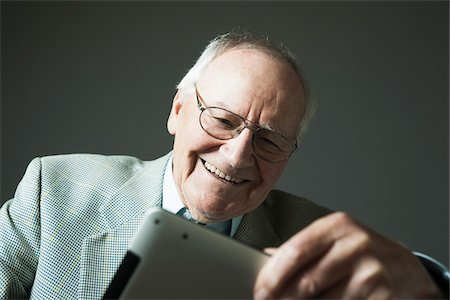 Senior Man using Tablet Computer, Studio Shot Stock Photo - Premium Royalty-Free, Code: 600-06819428