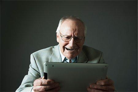 Senior Man using Tablet Computer, Studio Shot Stock Photo - Premium Royalty-Free, Code: 600-06819429