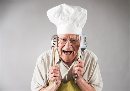 Senior Man with Cooking Utensils wearing Apron and Chef's Hat, Studio Shot Stock Photo - Premium Royalty-Free, Code: 600-06819434