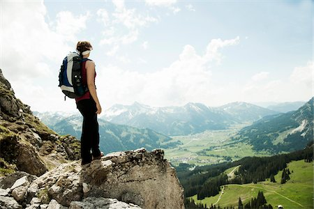 rugged landscape - Mature woman standing on cliff, hiking in mountains, Tannheim Valley, Austria Stock Photo - Premium Royalty-Free, Code: 600-06826339
