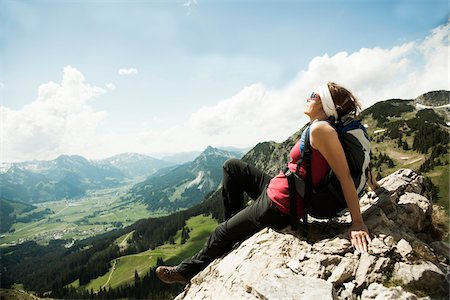 female hiking - Mature woman sitting on cliff, hiking in mountains, Tannheim Valley, Austria Stock Photo - Premium Royalty-Free, Code: 600-06826342
