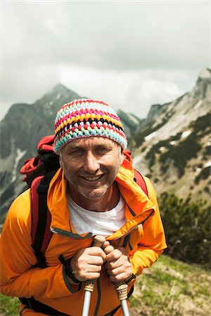 Close-up portrait of mature man hiking in mountains, Tannheim Valley, Austria Stock Photo - Premium Royalty-Free, Code: 600-06826355