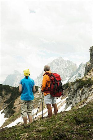 red - Backview of mature couple hiking in mountains, Tannheim Valley, Austria Stock Photo - Premium Royalty-Free, Code: 600-06826356