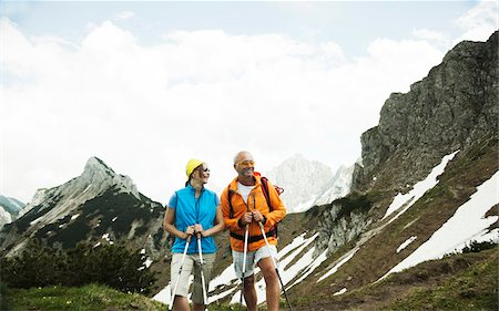 female hiking - Mature couple hiking in mountains, Tannheim Valley, Austria Stock Photo - Premium Royalty-Free, Code: 600-06826357