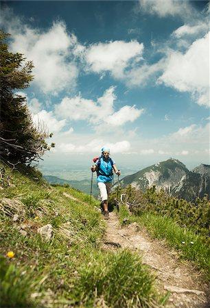 Mature woman hiking in mountains, Tannheim Valley, Austria Stock Photo - Premium Royalty-Free, Code: 600-06826358