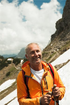 portrait looking away - Close-up Portrait of mature man hiking in mountains, Tannheim Valley, Austria Stock Photo - Premium Royalty-Free, Code: 600-06826364