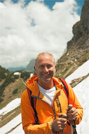 Close-up Portrait of mature man hiking in mountains, Tannheim Valley, Austria Stock Photo - Premium Royalty-Free, Code: 600-06826365