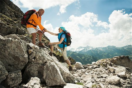 Mature couple hiking in mountains, Tannheim Valley, Austria Stock Photo - Premium Royalty-Free, Code: 600-06826377