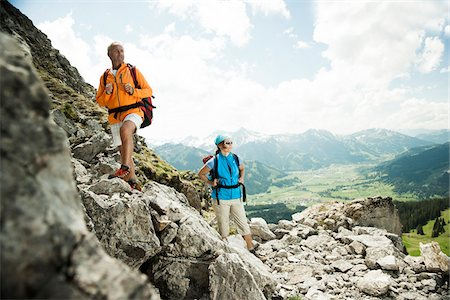 female hiking - Mature couple hiking in mountains, Tannheim Valley, Austria Stock Photo - Premium Royalty-Free, Code: 600-06826378