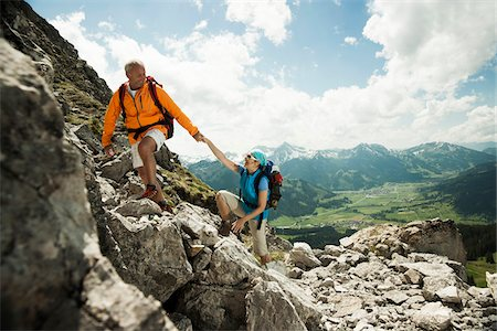 female hiking - Mature couple hiking in mountains, Tannheim Valley, Austria Stock Photo - Premium Royalty-Free, Code: 600-06826379