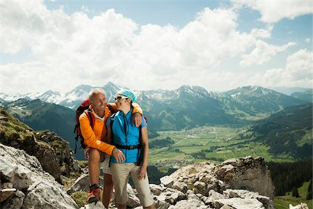 Mature couple hiking in mountains, Tannheim Valley, Austria Stock Photo - Premium Royalty-Free, Code: 600-06826381