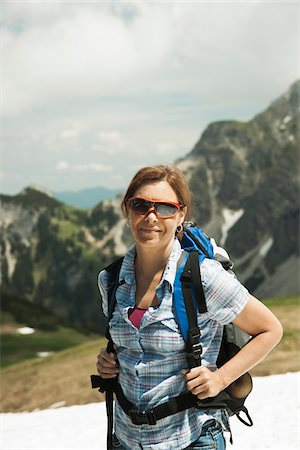 Portrait of mature woman hiking in mountains, Tannheim Valley, Austria Stock Photo - Premium Royalty-Free, Code: 600-06826383