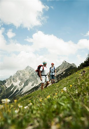 Mature couple hiking in mountains, Tannheim Valley, Austria Stock Photo - Premium Royalty-Free, Code: 600-06826394