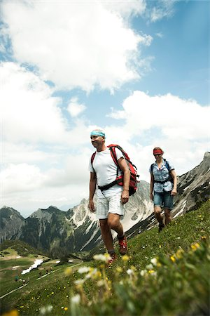 female hiking - Mature couple hiking in mountains, Tannheim Valley, Austria Stock Photo - Premium Royalty-Free, Code: 600-06826395