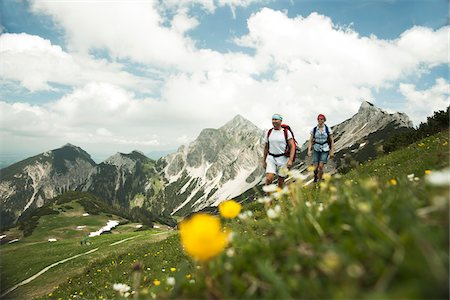 Mature couple hiking in mountains, Tannheim Valley, Austria Stock Photo - Premium Royalty-Free, Code: 600-06826396